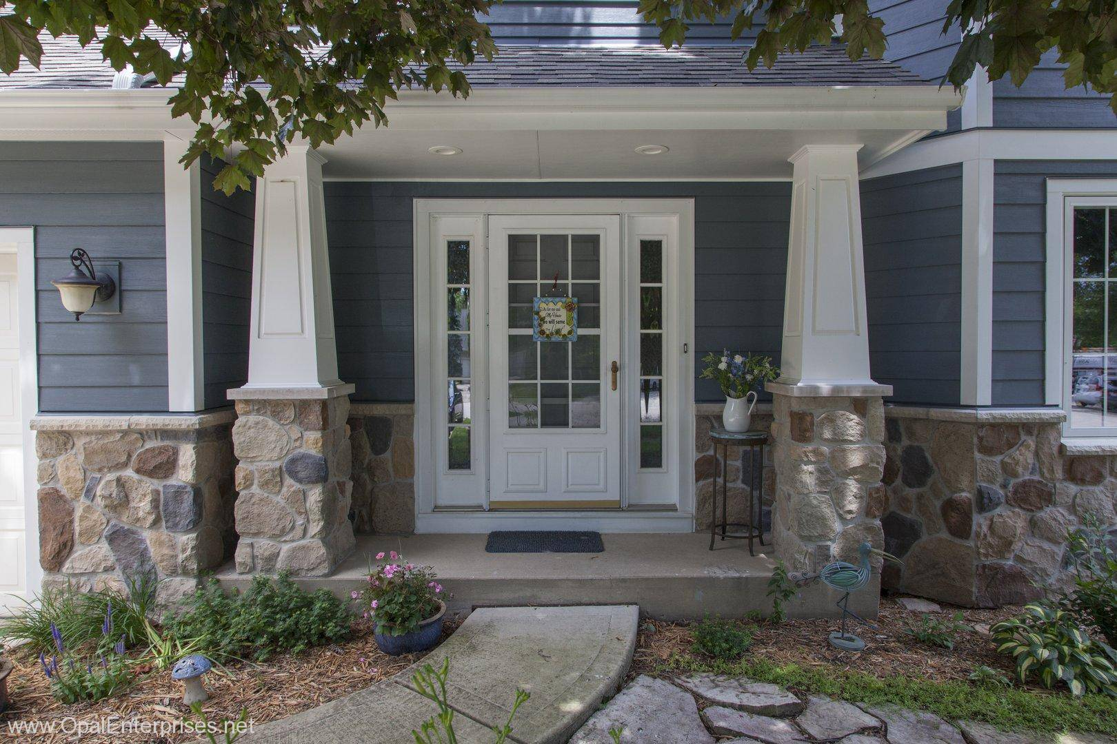 Good evening blue hardie siding stone accents andersen for Exterior home accents