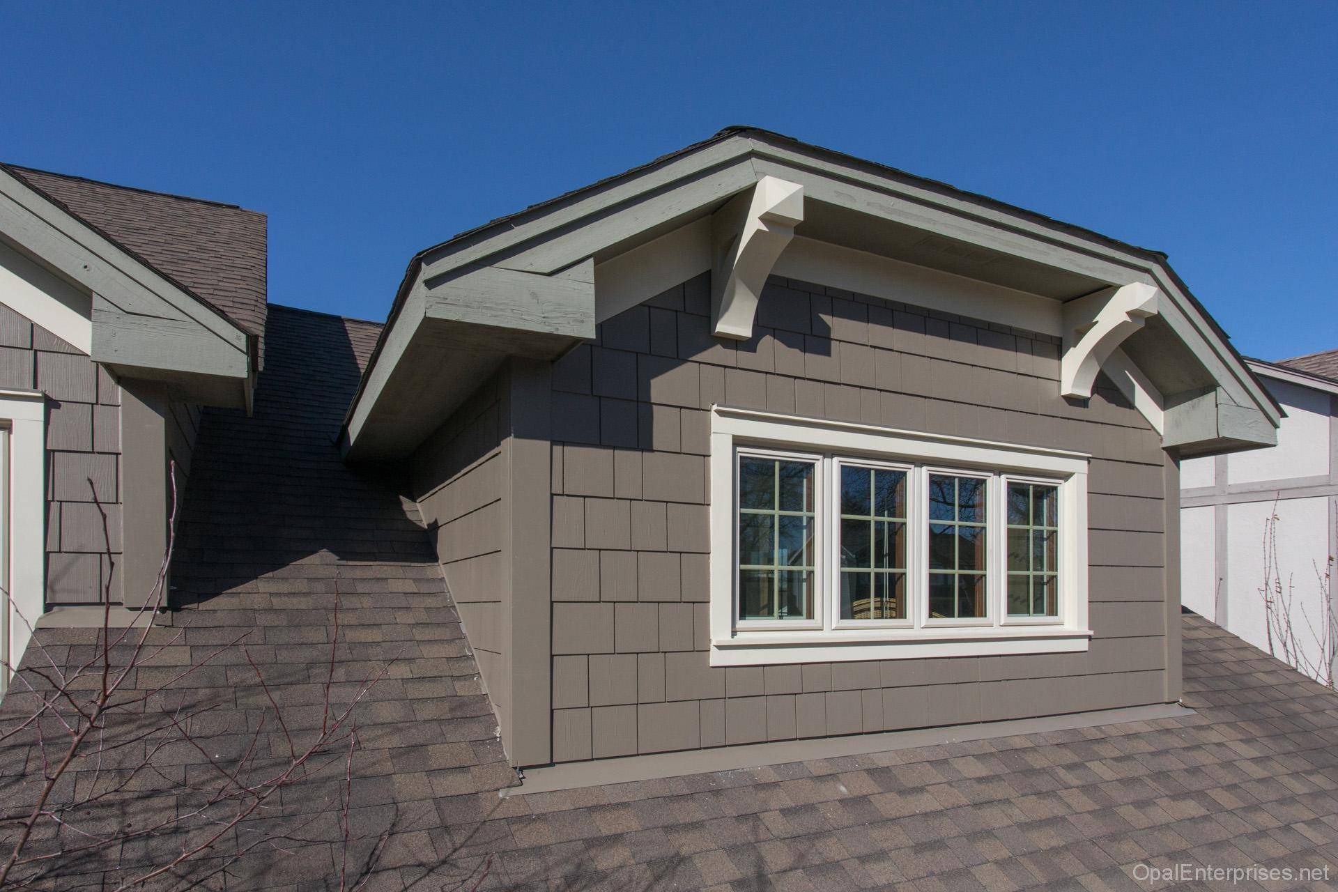 Naperville after siding and corbels installation on dormers