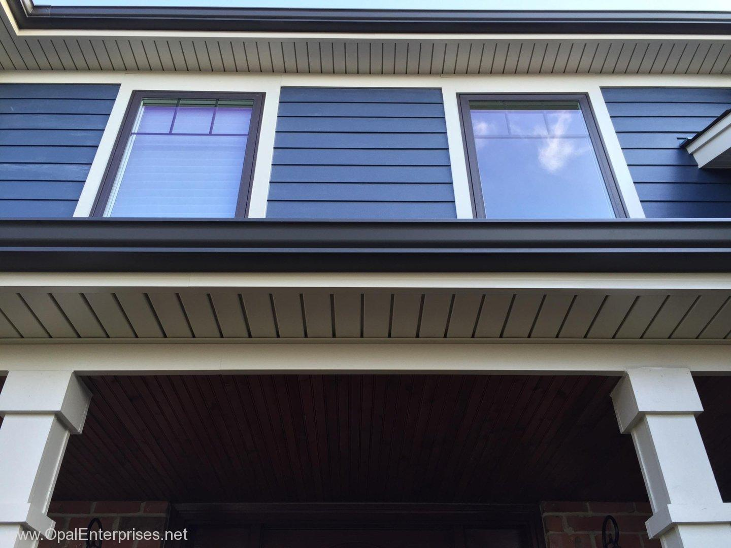 Deep Ocean James Hardie Siding paired with Andersen 100 Series Windows